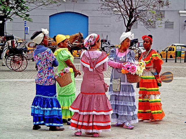 Ilustracja na wyjazd nurkowy na Kubę: kobiety w barwnych, tradycyjnych sukienkach, z koszami kwiatów.